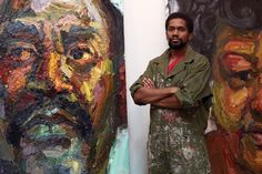 Sedrick Huckaby with two of his paintings