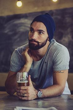 Simple grey t-shirt, simple blue beanie and a nicely groomed 'stache = perfection. Via BeardRevered.