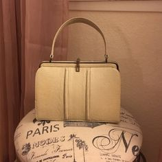 1950s saks fifth avenue purse It's vintage but it's in great condition. The inside is a peach pink color. The color is off white. Great for the vintage lover. saks fifth avenue Bags
