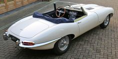 -- Second Rarest Jaguar E-Type -- 1961 JAGUAR E-TYPE OTS FLAT FLOOR with TWIN EXTERNAL BONNET LATCHES (car shown is fully restored) - Right Rear Three-Quarters View