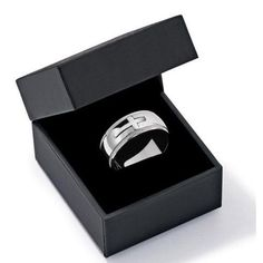 Durable polished stainless steel ring features a raised cross motif and decorative edging.- Comes in gift box.- Can be cleaned easily with a soft cloth.- Will not tarnish.