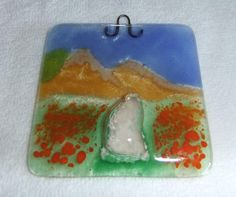 This beautiful cremation sun catcher is made to order and handcrafted in my studio in the USA. It's the perfect way to honor your beloved pet or loved one.  Each one will have a mountain and wild flower meadow with flower colors of your choice. The ashes form what looks like a gravel pathway through the meadow and up to the mountains. by addicted2glassfusion, $80.00