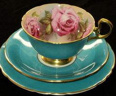 Chintz inside teal and pink roses tea cup. I can't help it: I've loved roses my whole life, and have amassed quite a collection of rose-centric cup-and-saucer sets already. I don't think I'm done yet!