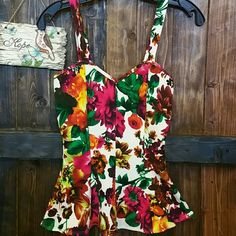 Floral Peplum Top Form fitting and cute floral peplum top features thick straps and textured material.  Fit: Fitted, Stretchy  BRAND NEW. San Julian Tops Tank Tops
