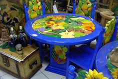Carved and painted dining table and chairs