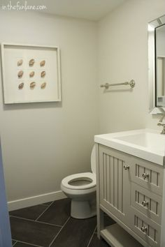 Home Depot light grey vanity, light grey walls, herringbone 12x24 dark grey tile