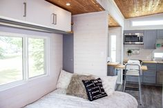 The bedroom with a queen size bed! There's ample storage above and a closet at the foot of the bed as well!