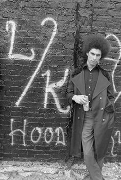 """Latin King leader 'Pinhead' in Chicago's Uptown Neighborhood during the mid-1970s. He's stading next to graffiti that says """"LK Hood."""" He was later murdered. 