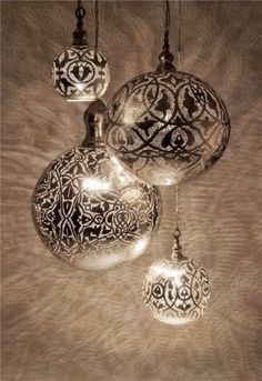 Silver spray paint over glass bulbs using a paper doily???