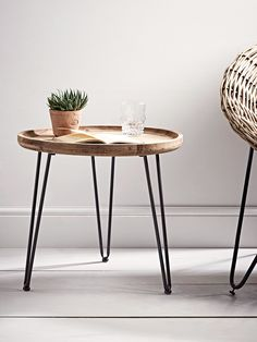 Carved from firwood with a natural finish that boasts exposed wood grain details, our simple round table has three hairpin grey iron legs. This simple, rustic table is perfect for beside your favourite arm chair and also looks great beside you Retro Dining Chairs, Table And Chairs, Dining Table, Console Table, Small Round Side Table, Small Tables, Side Tables, Metal Furniture, Table Furniture