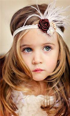 Flower Girl. I like the birdcage netting on headband.