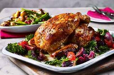 Spice up your Sunday roast with saffron-stuffed chicken, orange-roasted onions and crispy potatoes. See more Chicken recipes at Tesco Real Food. Roast Dinner, Sunday Roast, Roast Chicken Recipes, Beef Recipes, Recipies, Cooking Recipes, Yorkshire Pudding Recipes, Crushed Potatoes, Roasted Onions