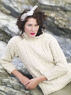 609c910e62046 doing this is a beautiful red cotton  debbie bliss ecoaran fair trade  classic cable sweater  free knitting pattern