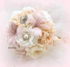 ***Made Upon Request- This piece can be made in ANY color scheme These pieces are exquisite and very romantic. This brooch bouquet has been crafted with the finest chiffon and lace, and has been decorated with decadent crystal and pearl brooches and silky feather flowers. I cant begin to