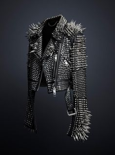 The leather jacket is the pallet and spikes are the paint.