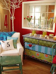 Love the fun color on the dresser.