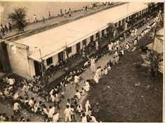 View from the roof of the old kitchen building.This was the day when tens of thousands of local hindus came out to support us after we were attacked. I was in charge of cooking for all of them and this view shows some of them being fed on the road along the inside of our boundary wall.
