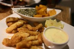 Fried calamari strips served with creamed spinach and roasted butternut. www.bluewaterscafe.co.za Fried Calamari, Creamed Spinach, Roasted Butternut, Fries, Cooking Recipes, Chicken, Food, Chef Recipes, Essen