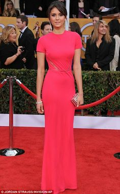 Vampire Diaries star Nina Dobrev looked vibrant in a fuchsia Elie Saab gown with narrow sheer slits
