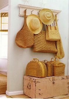 Basket Case, love the look of straw hats and baskets on a wall.