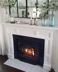 Nowadays, fireplace ideas come in a vent free gas or propane and electric fireplace. Modern fireplaces are built no more just with stone and brick. Now they are being built by marble and even glass. #fireplaceideas #fireplacediy #fireplacestone #fireplacebrick #fireplacecoastal #fireplacewithtv #fireplacecorner #fireplacerustic #fireplacefarmhouse #fireplaceworking #fireplacemodern #fireplacelivingroom #fireplaceelectric #fireplaceGas Fireplace Hearth Tiles, Fake Fireplace, Farmhouse Fireplace, Fireplace Remodel, Fireplace Surrounds, Fireplace Design, Fireplace Mantels, Victorian Fireplace Tiles, Fireplace Update