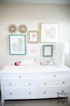 Baby girl nursery: wall gallery over changing table, ivie baby changing pad cover, coral and gold, touches of teal Teal Nursery, Nursery Room, Chic Nursery, Nursery Wall Collage, Nursery Dresser, Gallery Wall In Nursery, Light Pink Nursery Walls, Turquoise Nursery, Baby Gallery