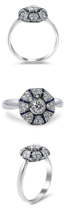 A stunning work of Art Deco-era artistry, this ring features a bezel-set old mine cut diamond surrounded by forty French cut sapphires and forty glittering diamond accents (approx. 0.64 total carat weigh. Circa 1930s.