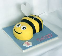 Bumble bee cake with edible wings. www.littlepartyboutique.co.uk www.facebook.com/TheLittlePartyBoutique Bumble Bee Cake, Bee Cakes, First Birthdays, Wings, Boutique, Facebook, Party, One Year Birthday, Fiesta Party