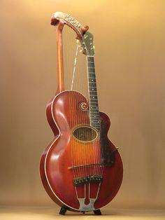 bushdog: GIBSON Style-U 1917 In case you dont know its a Harp Guitar --- https://www.pinterest.com/lardyfatboy/