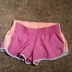 Nike dri fit shorts Nike shorts pink with orange and grey  pics are the color exactly. Like new condition! Nike Shorts