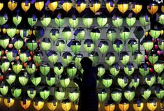 December 31, 2017:  A woman prays in front of lanterns to celebrate the New Year at Jogyesa Buddhist temple in Seoul, South Korea.