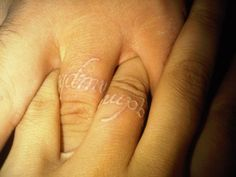 "My boyfriend and I got matching white ink tattoos on our ring fingers.  They say ""qqdmv"" which stands for Que Quieres De Mi Vida (what do you want from my life) ?  This is something we say to each other when we want to really understand each other.  We got them on our ring fingers to essentially work as place holders for my engagement ring and our wedding rings.  When our rings go on, its as if they are an answer to the question.    It took us a VERY long time to find an artist willing to do…"