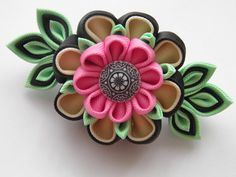 Handmade kanzashi flower french barrette. The handmade Kanzashi flower made of grosgrain ribbon is apprx.10x5 cm.(4 x 2) ,with a glass bead embellishment. Mounted on a 7.5 cm(3) french barrette .    I always use the highest quality ribbon and materials.  All hair accessories made of ribbon and satin fabric are heat sealed to prevent fraying.    My accessories are all handmade and designed exclusively by me in my studio in Essex(smoke/pet free).  If youve got any questions, please feel free…