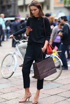 This model-off-duty showed off the unofficial uniform in easy black on black.