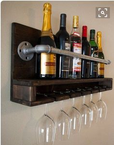 Industrial and reclaimed stained wood wine or alcohol shelf. Holds six glasses. Measures 30 inches long by 12 inches tall.