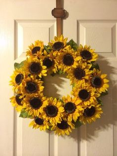 The perfect chic summer wreath, on a hay base, filled with leaves and sunflowers. 16 diameter. You may add a black capital letter for $10.00. If you purchase the wreath with letter, please include which letter you would like in the notes at checkout.