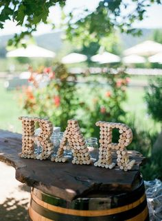 "Winery wedding decor for a Prince Edward County #bayofquinte wedding: ""BAR"" Sign out of corks 