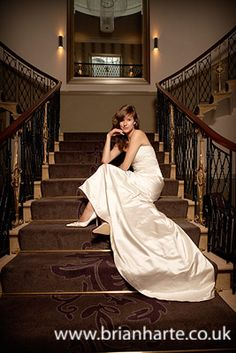 Elegant photo of a bride sitting on the stairs