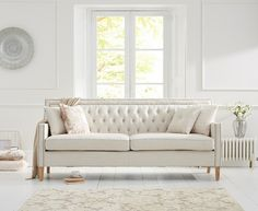 Buy the Chatsworth Chesterfield Ivory Fabric 3 Seater Sofa at Oak Furniture Superstore