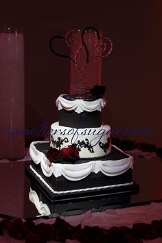 www.tiersofsugar.com.  Red and Black Cake