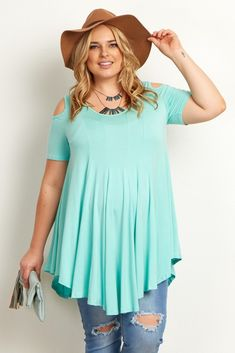 Show a little shoulder with this open cutout plus size maternity top. Its solid hue and flattering free flowing style will give you a modern chic look day or night. Transition to a fun night out by adding a bit of sparkle with a statement necklace.