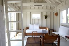 Love this cot with pillows. Great little weekend house. Fire Island House | Remodelista