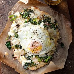 Grilled Flatbread Pizzas with Greens, Ricotta & Eggs. We love putting a fried egg on top of pizza!