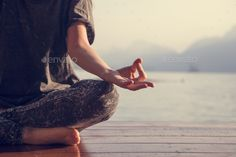Buy Woman practicing yoga by a lake by Rawpixel on PhotoDune. Woman practicing yoga by a lake Pranayama, Asana, Karma Yoga, Sept Chakras, Chakra Du Plexus Solaire, Yoga During Pregnancy, Do Exercise, Health Center, Health And Fitness Tips