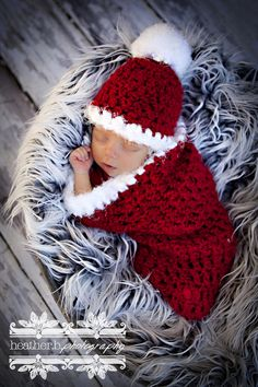 This gorgeous red and white Santa Claus newborn photography cocoon prop is made from a super soft acrylic boucle yarn with fuzzy trim. I have crocheted it in a looser stitch so that babies little bits