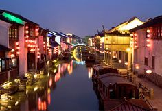 """Weeping willows & pagoda-roofed homes cling to the sides of Suzhou's canals. The city was founded 2,500 years ago, & its historic core, especially its two canal """"streets"""" -the 800 yr-old Pingjiang Road & the 1,200-yr-old Shantang Road, make it one of the top draws in China. A major center for the production of silk, Suzhou is also famed for its classical gardens & its own """"leaning tower,"""" the octagonal Yunyan Pagoda, which was built in 961 and, more than a millennium later, slants…"""