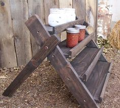 Rustic Four Tiered Stand - perfect for candle display at a craft fair.