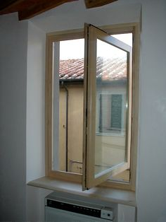 Finestra in legno di Acero a bilico verticale