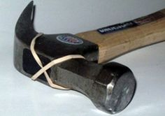 use a rubber band on hammer head when removing nails from a wall to avoid damaging the wall: genius