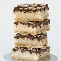 I love coconut, and chocolate… so naturally Almond Joy candy bars are one of my favorites.  This homemade spin on the classic candy bar has all the flavors of Almond Joy candy, with an additional element… a buttery crust.  The resulting combination is a rich and delicious treat! This recipe is made in a 9″x13″ …